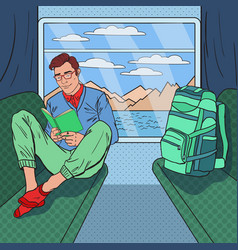 Pop art man travelling by train and reading book vector