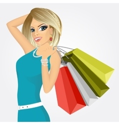 Smiling young woman with shopping bags vector