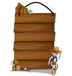 A cowboy and the empty wooden signboards vector image
