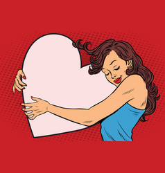 Beautiful young woman hugging valentine heart vector