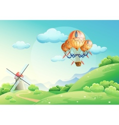 Summer fields with a balloon in the sky vector