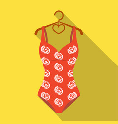 crashing red swimsuit with a print of roses beach vector image