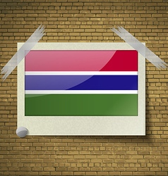 Flags gambia at frame on a brick background vector