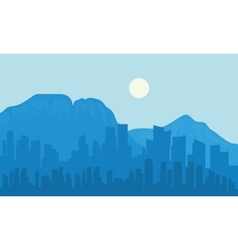 Silhouette of big city and moon vector