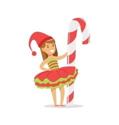 Girl with giant candy cane stick dressed as santa vector
