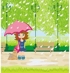 girl walking the dog in the rain vector image