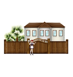 A housemaid in front of the big house vector