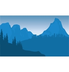 silhouette of city on mountain vector image