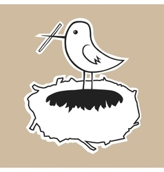 The bird builds a cozy nest vector