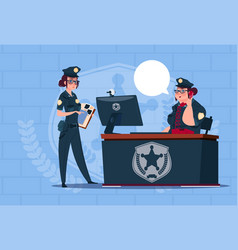 Two police women working on computer wearing vector