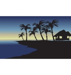 Silhouette of hut and palm vector
