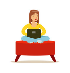 happy young woman sitting in a red pouf and using vector image