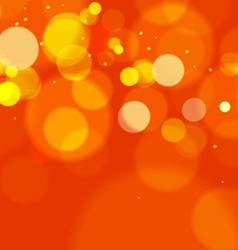 Abstract orange bokeh lights background vector
