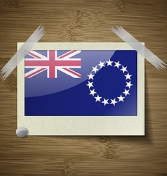 Flags cook islands at frame on wooden texture vector