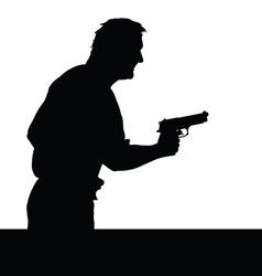 Man with gun silhouette vector
