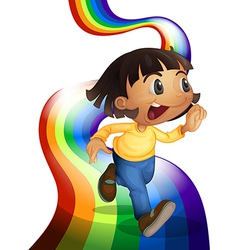 A rainbow with a child playing vector image