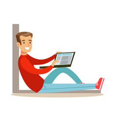 Young man sitting on the floor with his laptop vector
