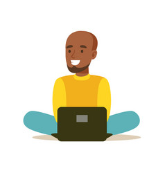 Young man sitting on the floor and using laptop vector