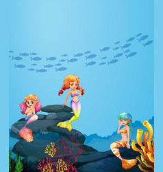 Three mermaids swimming under the ocean vector