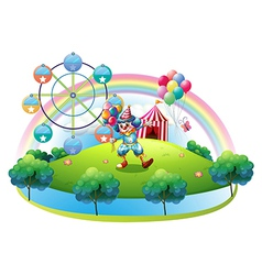 A clown with balloons at the carnival in the vector image vector image