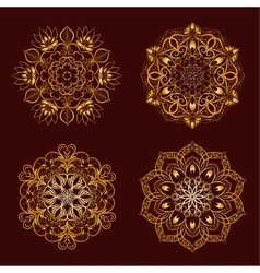 Set from gold color mandala over dark brown vector