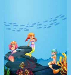 Three mermaids swimming under the ocean vector