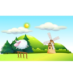 A sheep jumping at the fence with a windmill at vector image
