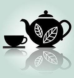 Silhouette teapot with cup vector