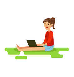 Young woman sitting on the floor with her laptop vector
