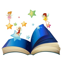 A book with three floating fairies vector image vector image
