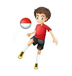 A boy using the ball with the Monaco flag vector image vector image