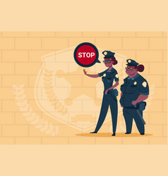 Two african american police women holding stop vector