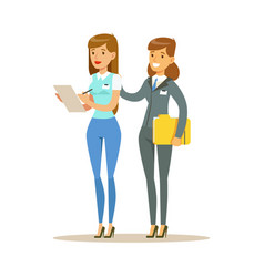 Two young woman working together in office vector