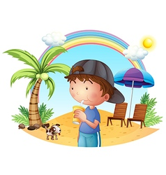 A young boy at the beach with his pet vector image vector image