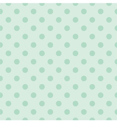 Seamless pattern with mint green polka dots vector