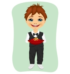 Little boy holding wedding rings on cushion vector