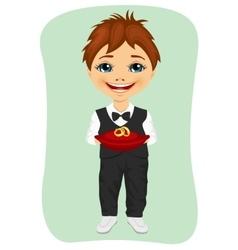 Little boy holding wedding rings on cushion vector