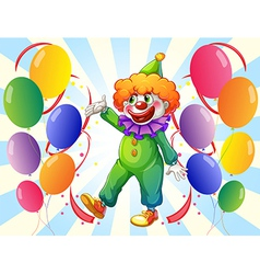 A male clown in the middle of the balloons vector