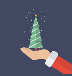 santa claus hand holding christmas tree vector image vector image