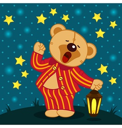 Teddy bear in pajamas yawns vector