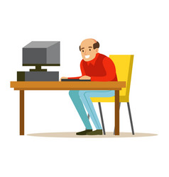 Smiling bald man working on a computer at his vector