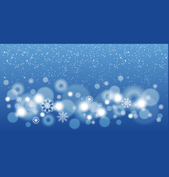 blue christmas background with snowflakes bokeh vector image