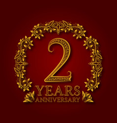 golden emblem of second years anniversary vector image