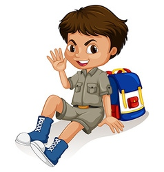 Little boy sitting by his backpack vector image vector image