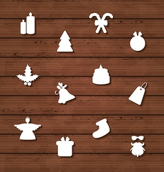 Set Christmas design elements on wooden texture vector image vector image