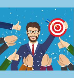 businessman holding up a winning target vector image