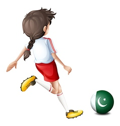 A girl kicking the ball with the flag of Pakistan vector image