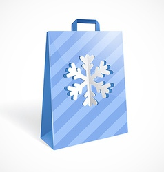 Festive paper bag with cut out snowflake for your vector