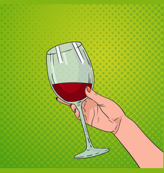 hand holding glass of red wine pop art retro pin vector image