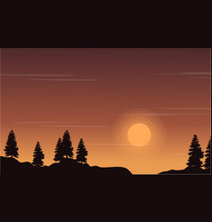 At sunset tree on the hill landscape vector
